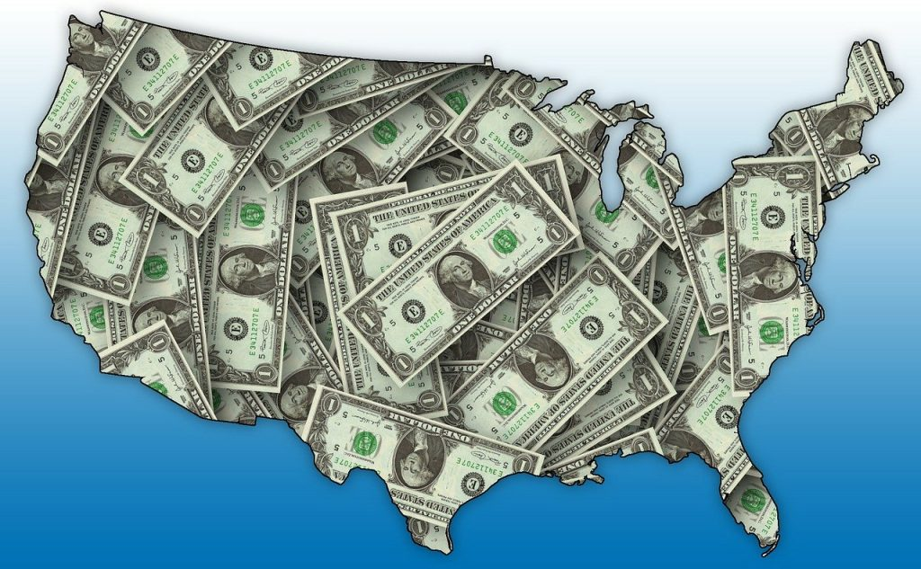 An outline of the Unites States filled in with images of one dollar bills, reflecting the predominance of money in our elections.