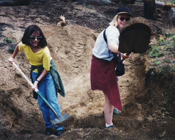 Two students are shown in an old photograph shoveling dirt, working on wildfire reclamation for a botany class in school, circa 1996.  Student on right is author.