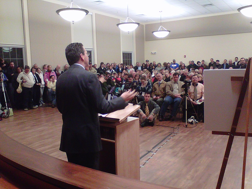 A crowded town hall meeting in Torrington, CT in 2011.  These citizens are part of a culture of democracy.