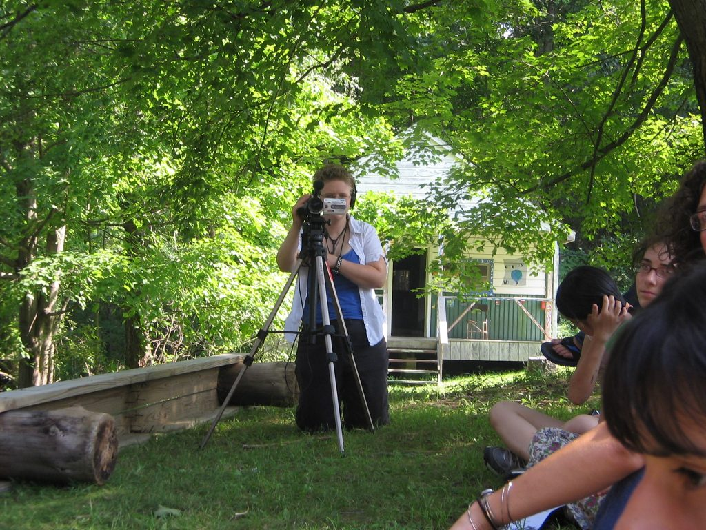 The author operates a video camera at a youth summer camp in the woods of upstate New York in 2006.  National service like this can facilitate a culture of democracy.