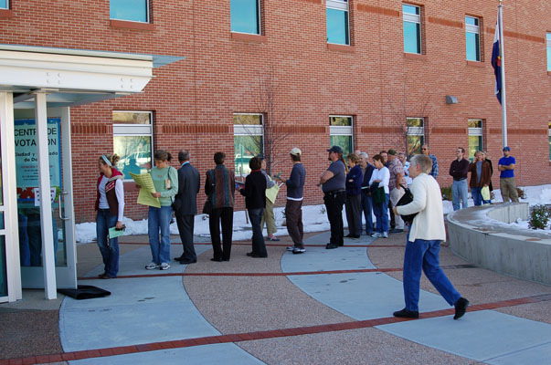A long line of voters outside a polling place in Denver in 2006.  These citizens are participating in a culture of democracy.