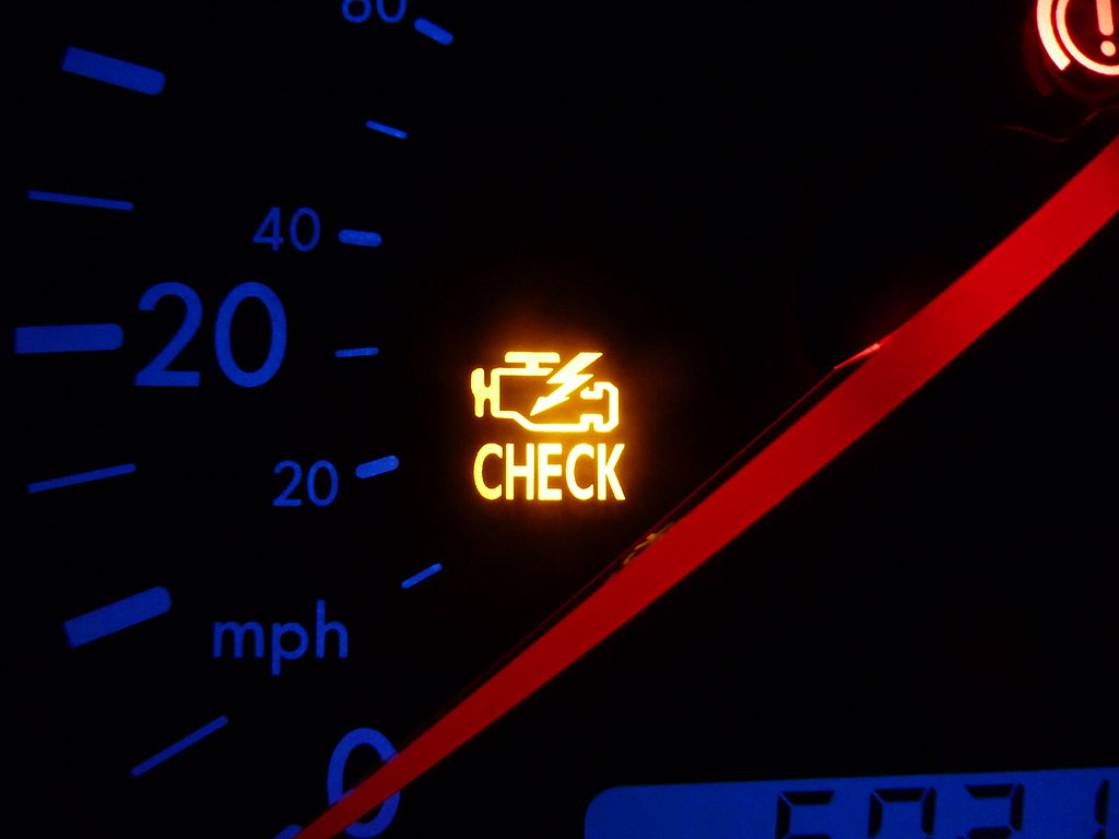 A lit up check engine light is shown next to a speedometer.  Worry is like a check engine light in our minds.