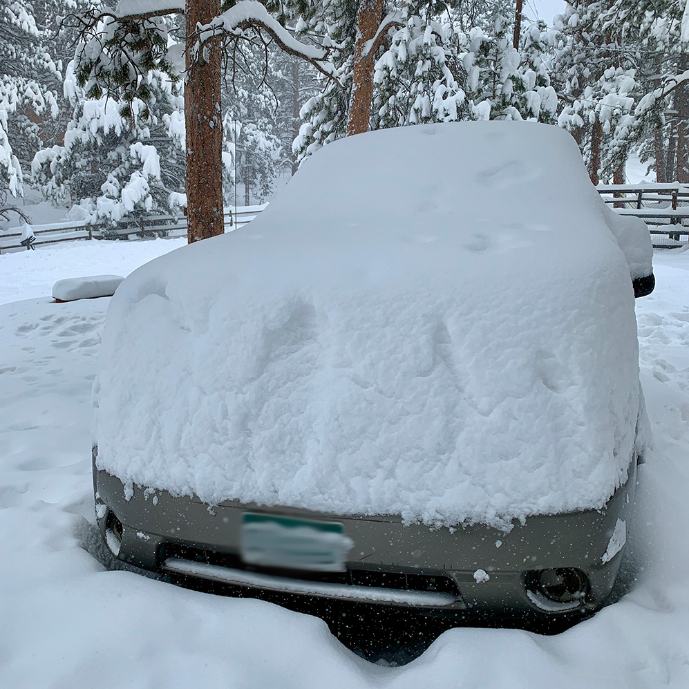 An SUV buried in deep snow.